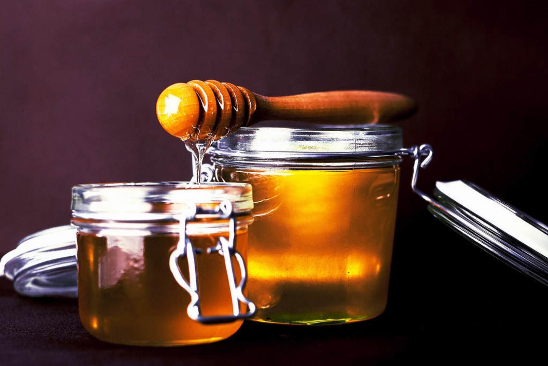 Hölzerner Honiglöffel